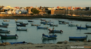 Coast of Asilah and boats . Explore Morocco with Trek Morocco Desert